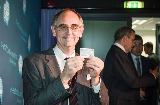 Edward Lucas holding e-residency card