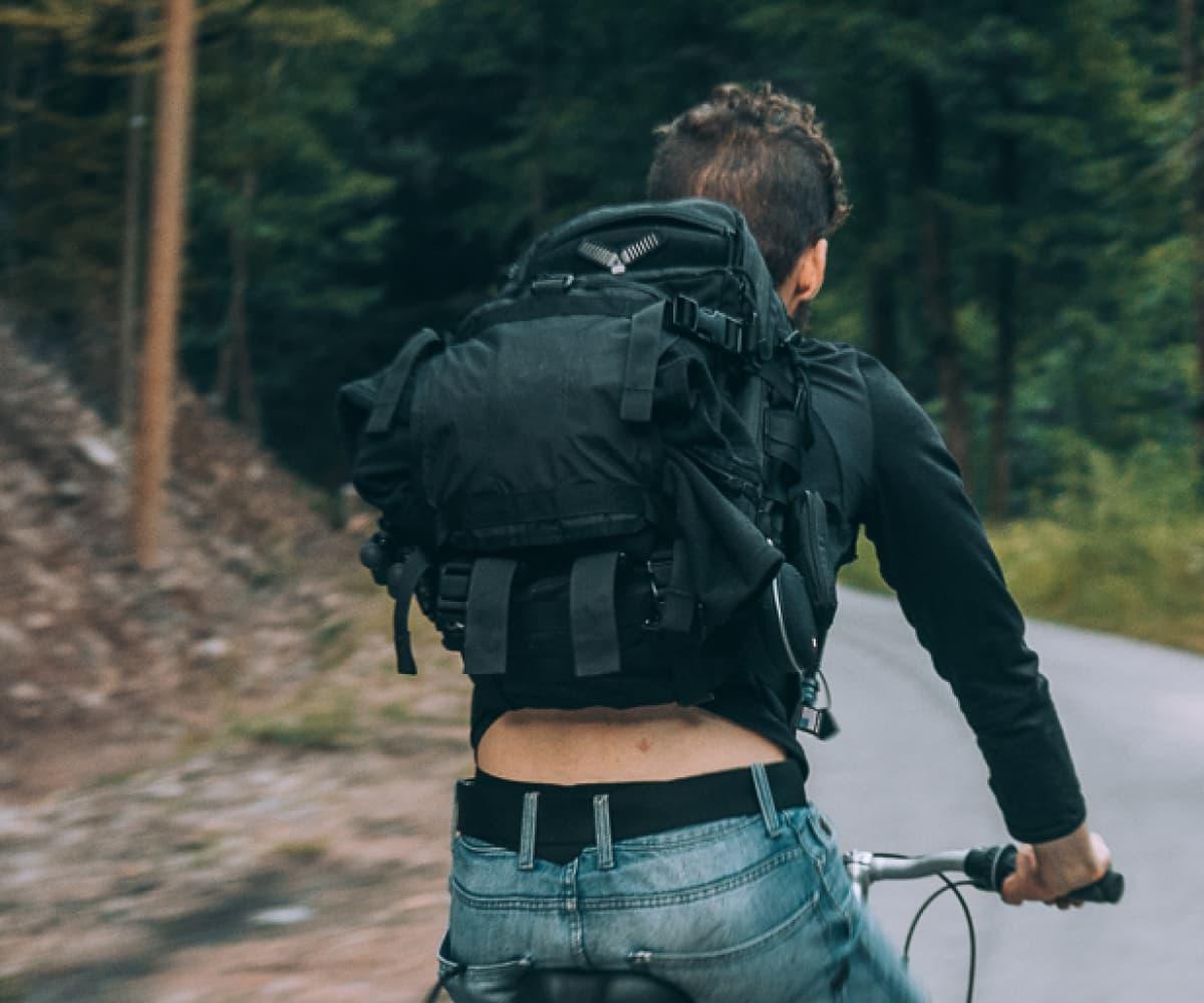 Image of man biking
