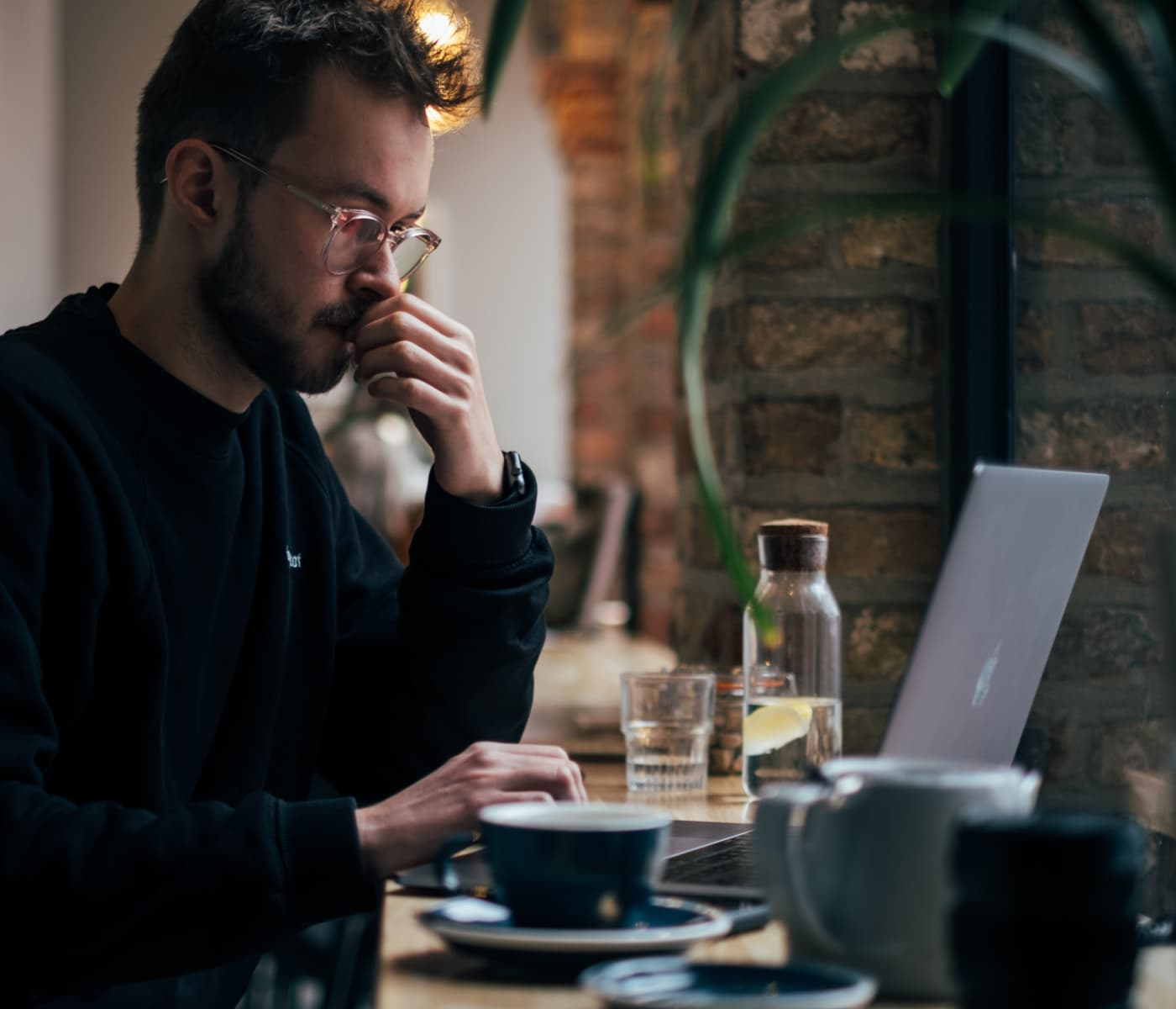 Image of man working in cafe