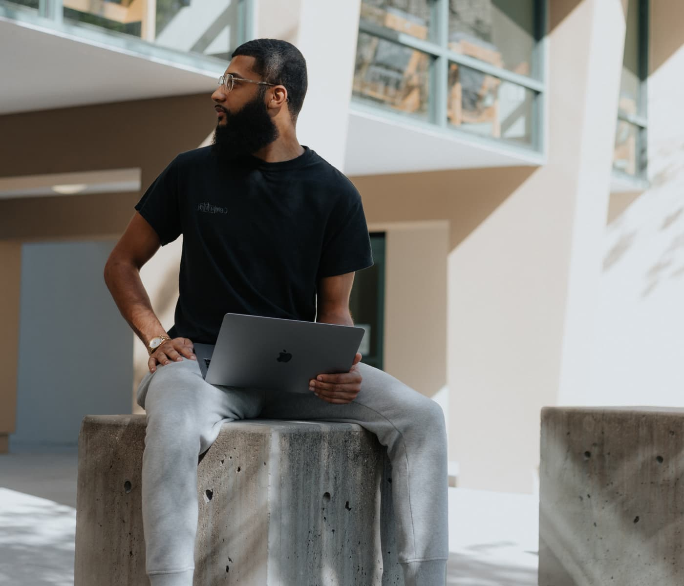 Image of man with beard working with laptop