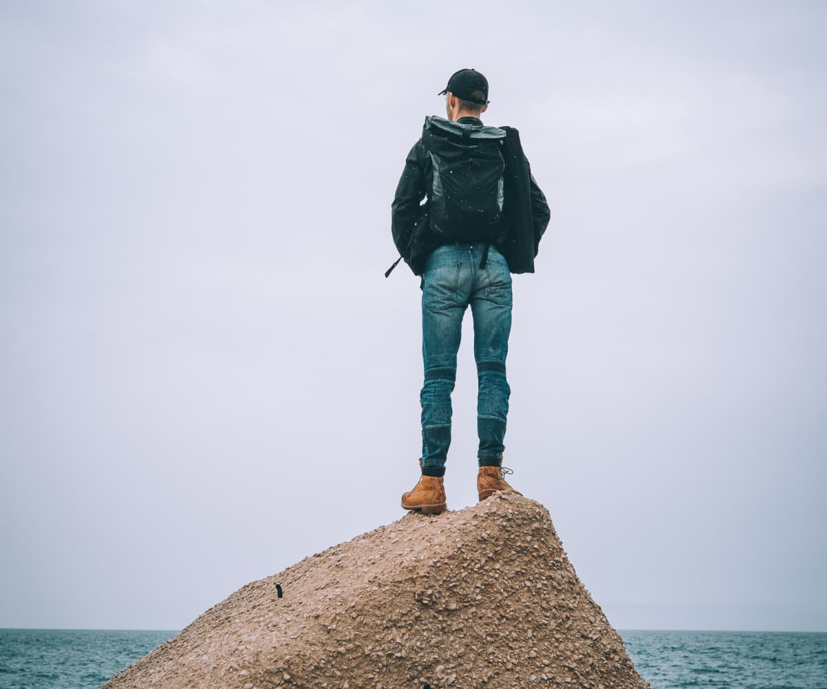 Image of man standing on a rock
