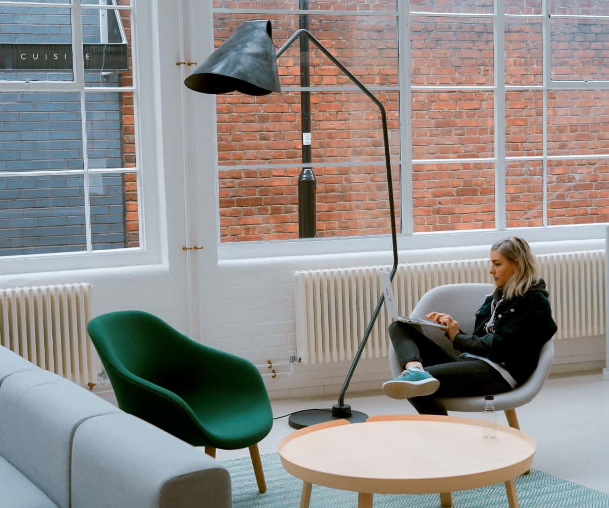 Image of woman sitting in office