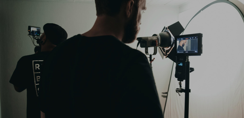Image of man behind camera