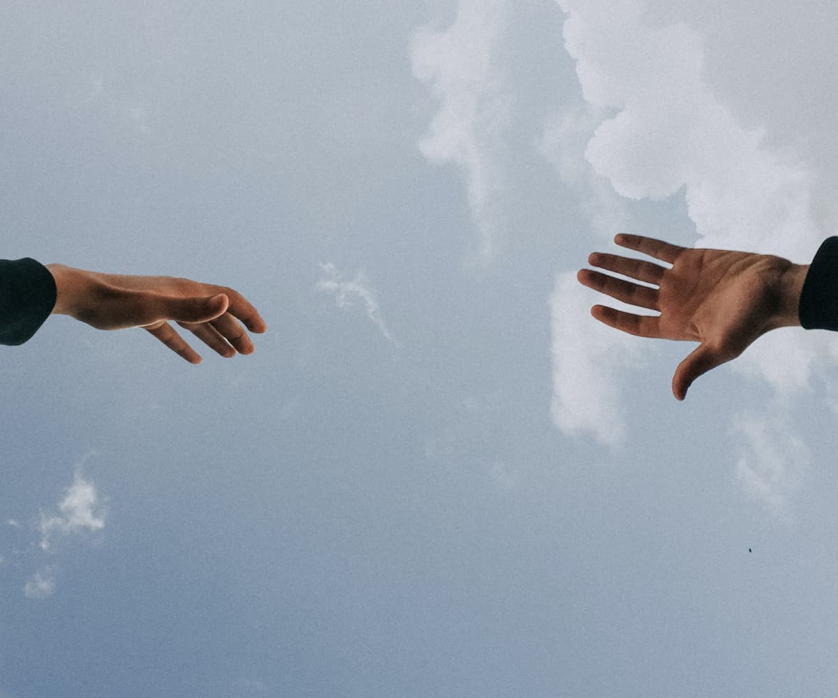 Image of hands in the sky