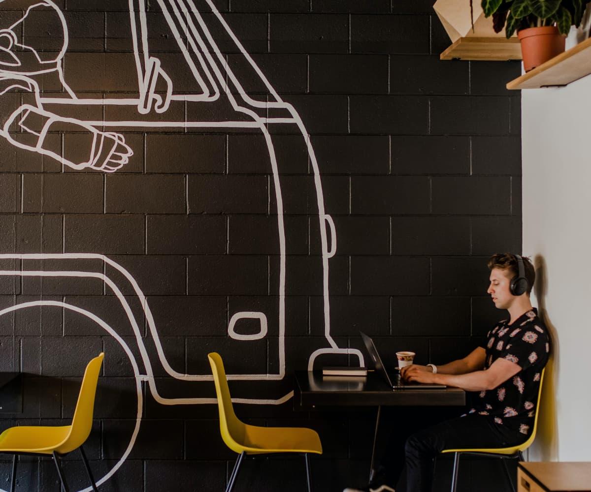 Image of freelancer working in cafe