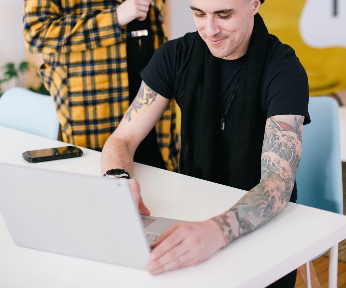 Image of man behind laptop